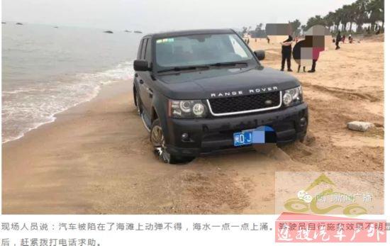 路虎越野车近距离看海轮陷海滩 绞盘来施教